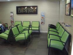 Comfortable waiting room equipped with large screens